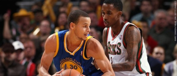 121015121305-stephen-curry-brandon-jennings-posts-up-101512-story-top